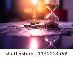 sand running through the shape... | Shutterstock . vector #1145253569