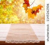 empty tableclothe on wooden... | Shutterstock . vector #1145262506