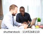 smiling aged businessman... | Shutterstock . vector #1145268110