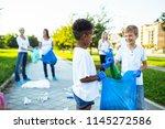 volunteers with garbage bags... | Shutterstock . vector #1145272586