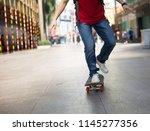 skateboarder legs riding... | Shutterstock . vector #1145277356