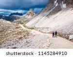 mountain hikers with trekking... | Shutterstock . vector #1145284910