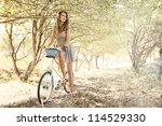 Young Woman With Retro Bicycle...