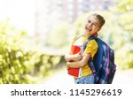 pupil of primary school with... | Shutterstock . vector #1145296619