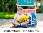happy little kid boy with... | Shutterstock . vector #1145307749