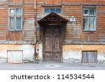 old door and window closeup of wooden house - stock photo
