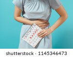 cropped illness woman in blue... | Shutterstock . vector #1145346473