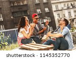 group of friends hangout at the ... | Shutterstock . vector #1145352770