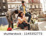 group of friends hangout at the ... | Shutterstock . vector #1145352773