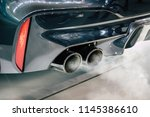 dual exhaust pipe close up with ... | Shutterstock . vector #1145386610