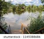 view of the lake in the... | Shutterstock . vector #1145388686