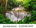 waterfall in deep rain forest... | Shutterstock . vector #1145401949