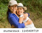 mother and daughter happily... | Shutterstock . vector #1145409719