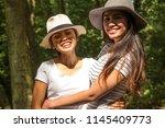 two asian girls  happy  posing... | Shutterstock . vector #1145409773