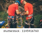 male rescuer climbers with... | Shutterstock . vector #1145416763