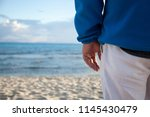 a man whose hand is only... | Shutterstock . vector #1145430479