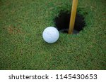 golf ball and hole on green...   Shutterstock . vector #1145430653