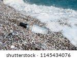 glass bottle that overgrown...   Shutterstock . vector #1145434076