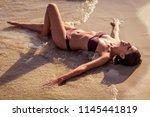 beautiful young woman in bikini ... | Shutterstock . vector #1145441819