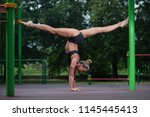 sports acrobatics girl stands...   Shutterstock . vector #1145445413
