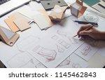 designer sketching drawing... | Shutterstock . vector #1145462843