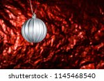 silver new year's ball on a red ... | Shutterstock . vector #1145468540