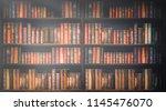 blurred bookshelf many old... | Shutterstock . vector #1145476070