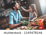 handsome man and his little... | Shutterstock . vector #1145478146