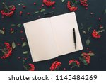 Small photo of Flat lay blank diary pages top view mock up copy space on wooden background decorated with wild berry fruit arrangement