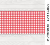 red tablecloth on white wood... | Shutterstock .eps vector #1145523809