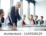 upset displeased senior... | Shutterstock . vector #1145528129