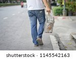 man holding  mouse trap  at... | Shutterstock . vector #1145542163