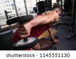 muscular young man doing heavy... | Shutterstock . vector #1145551130