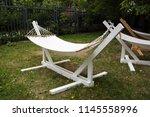 garden hammock for rest in the...   Shutterstock . vector #1145558996