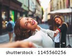 two young happy women in the... | Shutterstock . vector #1145560256