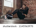 fit young woman doing crunch... | Shutterstock . vector #1145563970