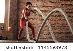 athlete moving the ropes in... | Shutterstock . vector #1145563973