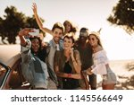 group of young men and women... | Shutterstock . vector #1145566649