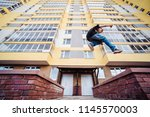 teenage boy on a street in a... | Shutterstock . vector #1145570003