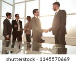 employee accepts... | Shutterstock . vector #1145570669