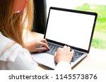 woman using laptop computer on... | Shutterstock . vector #1145573876