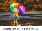 happy child girl with an... | Shutterstock . vector #1145575013