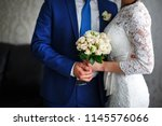 wedding bouquet at bride's and... | Shutterstock . vector #1145576066