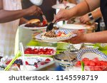 people sharing food at a summer ... | Shutterstock . vector #1145598719