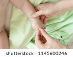 fingers massage for newborn... | Shutterstock . vector #1145600246