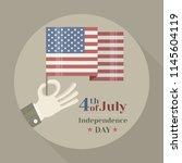 hand holding american national... | Shutterstock .eps vector #1145604119