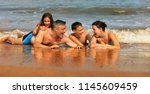 happy family sunbathing | Shutterstock . vector #1145609459