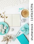 workspace with open notebook on ... | Shutterstock . vector #1145619296