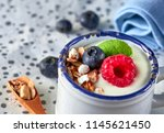 yogurt with muesli  raspberry ... | Shutterstock . vector #1145621450
