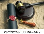 Small photo of Last will and testament on yellowish paper with wooden judge gavel document is mock-up